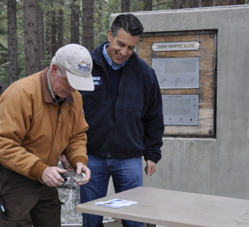 Nevada Governor Brian Sandoval getting his Nevada State Parks Passport stamped at Sand Harbor, Lake Tahoe