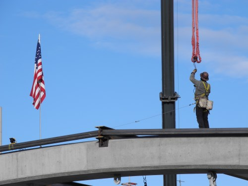 Virginia Street Bridge worker atop one of the new arches, Reno, Nevada